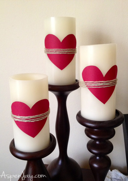 simple valentines decorations- hearts on candles with twine