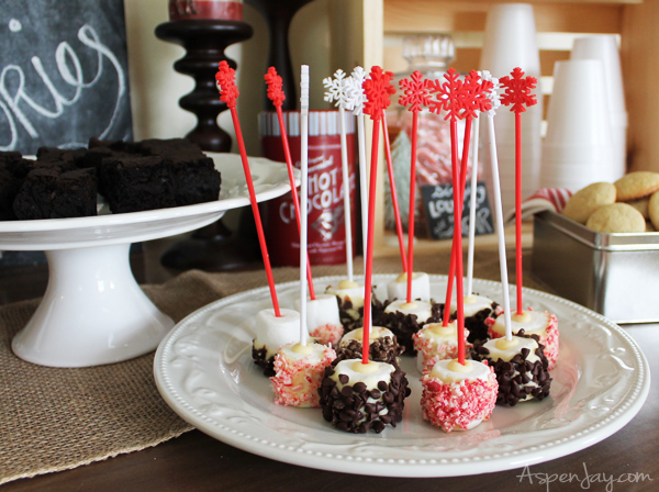 Marshmallow stir sticks- so clever! Love the snowflake on top.Rustic Hot Chocolate Bar at a Caroling Party. So Fun! I need to plan one next year!