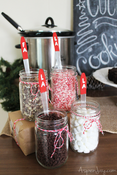 Variety of toppings. Cute spoons to keep the caroling theme. Rustic Hot Chocolate Bar at a Caroling Party. So Fun! I need to plan one next year!