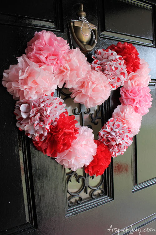 Tissue paper heart wreath tutorial. Inexpensive and pretty heart craft to make for Valentines. Super cute!